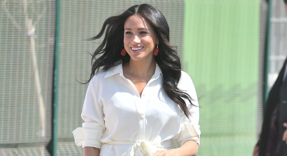 Meghan wore a simple white shirt dress for the final day of the royal tour. [Photo: Getty]
