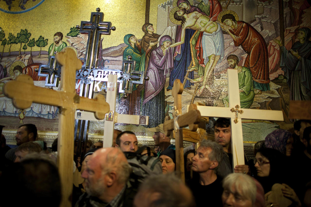 Worshippers carry wooden crosses at the Church of the Holy Sepulchre during the Good Friday procession and the Way of the Cross, in Jerusalem's Old City, Friday, April 22, 2011. Christian pilgrims from around the world filled the narrow cobblestone streets of Jerusalem's Old City on Good Friday, some carrying large wooden crosses as they followed the route Jesus took on the way to his crucifixion.