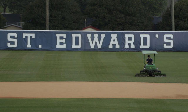 St. Edwards' Lucian-Hamilton Baseball Field is mowed as it remains closed due to the coronavirus outbreak, Tuesday, May 5, 2020, in Austin, Texas. In response to the economic impact of COVID-19, St. Edwards says they are cutting six sports programs including men's and women's tennis, men's and women's golf and men's soccer; St. Edwards' baseball will not be part of the cut. (AP Photo/Eric Gay)