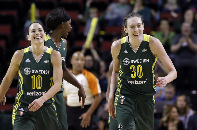 Seattle Storms' Sue Bird (10) and Breanna Stewart (30) smile as they leave the court for a timeout against the Connecticut Sun in a WNBA basketball game Saturday, May 28, 2016, in Seattle. (AP Photo/Elaine Thompson)