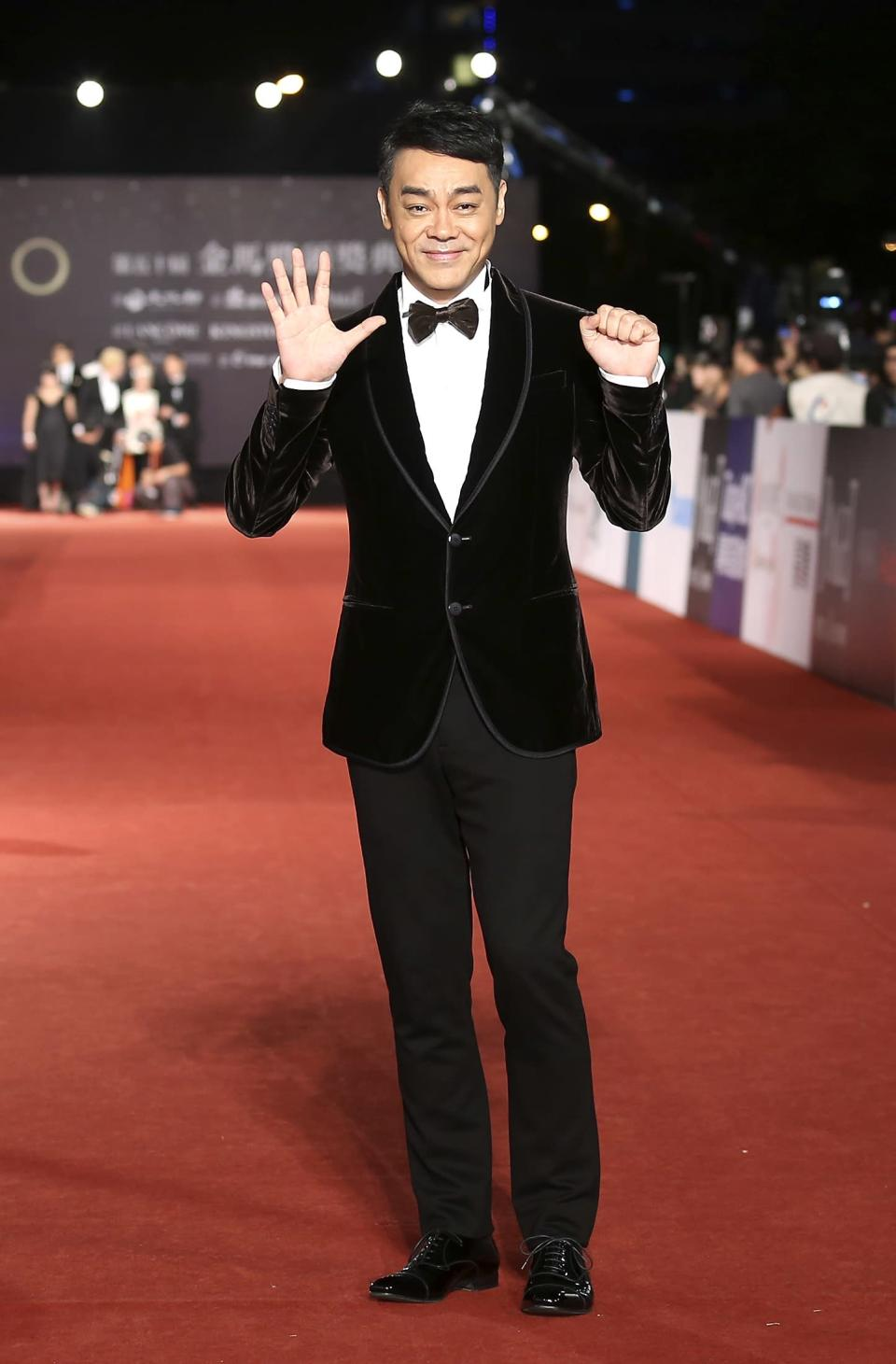Hong Kong actor Sean Lau poses for photographers on the red carpet at the 50th Golden Horse Film Awards in Taipei November 23, 2013. REUTERS/Patrick Lin (TAIWAN - Tags: ENTERTAINMENT)