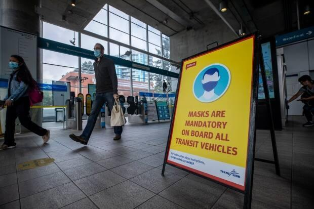 People at a Vancouver SkyTrain on the first day of TransLink's mandatory mask rule on Aug. 24, 2020.  (Ben Nelms/CBC - image credit)