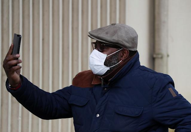 A man wearing a mask leaves hospital in Creil, Paris, where people tested positive for coronavirus have been treated (Reuters)