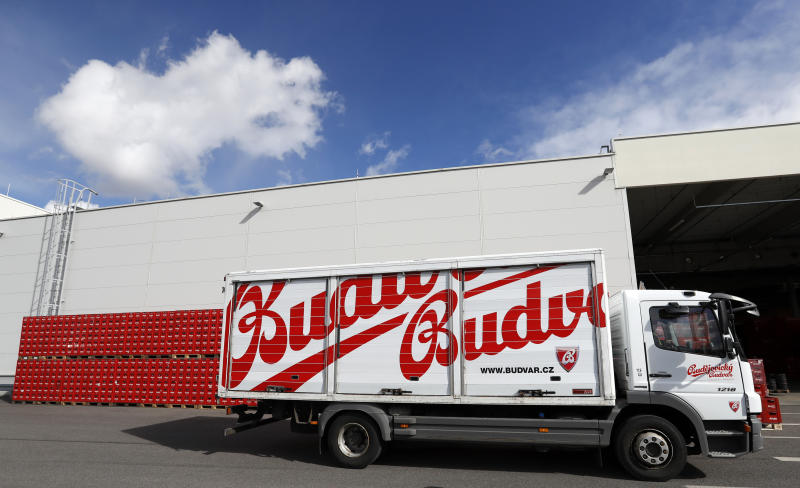 In this photo taken on Monday, March 11, 2019, a truck drives past cases of beer at the Budejovicky Budvar brewery in Ceske Budejovice, Czech Republic. The Budejovicky Budvar brewery in the Czech Republic managed to survive a decades-long trademark battle over whether it could call its beer Budweiser. But now it faces another potential threat: Brexit. The United Kingdom is one of the brewer's top five markets, and like many other businesses, it's concerned about what will happen if Britain leaves the European Union without an agreement governing trade. (AP Photo/Petr David Josek)