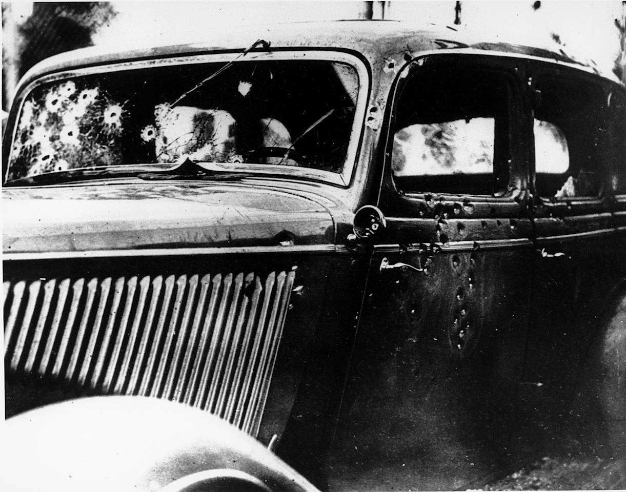 The bullet-riddled automobile in which the bandits, Clyde Barrow and Bonnie Parker, were trapped, shot and killed on a Louisiana road is seen May 24, 1934.  Officers waited for the desperados near Arcadia, La., and pumped 167 bullets into the car.  (AP Photo)