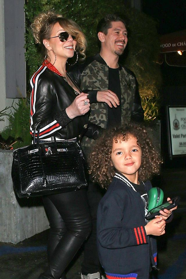 <p>Mimi was all smiles on Thursday night as she and boyfriend Bryan Tanaka took her son, Moroccan, to dinner at New York's posh Brazilian steakhouse Fogo de Chão. Do they have chicken fingers on the menu there? (Photo: GAMR/BackGrid)<br /><br /></p>