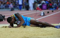 LONDON, ENGLAND - AUGUST 09: Leevan Sands of the Bahamas lays on the sand after getting injured in the Men's Triple Jump Final on Day 13 of the London 2012 Olympic Games at Olympic Stadium on August 9, 2012 in London, England. (Photo by Stu Forster/Getty Images)