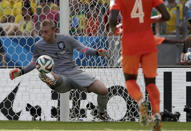 Netherlands' goalkeeper Jasper Cillessen saves a shot during the World Cup round of 16 soccer match between the Netherlands and Mexico at the Arena Castelao in Fortaleza, Brazil, Sunday, June 29, 2014. (AP Photo/Marcio Jose Sanchez)