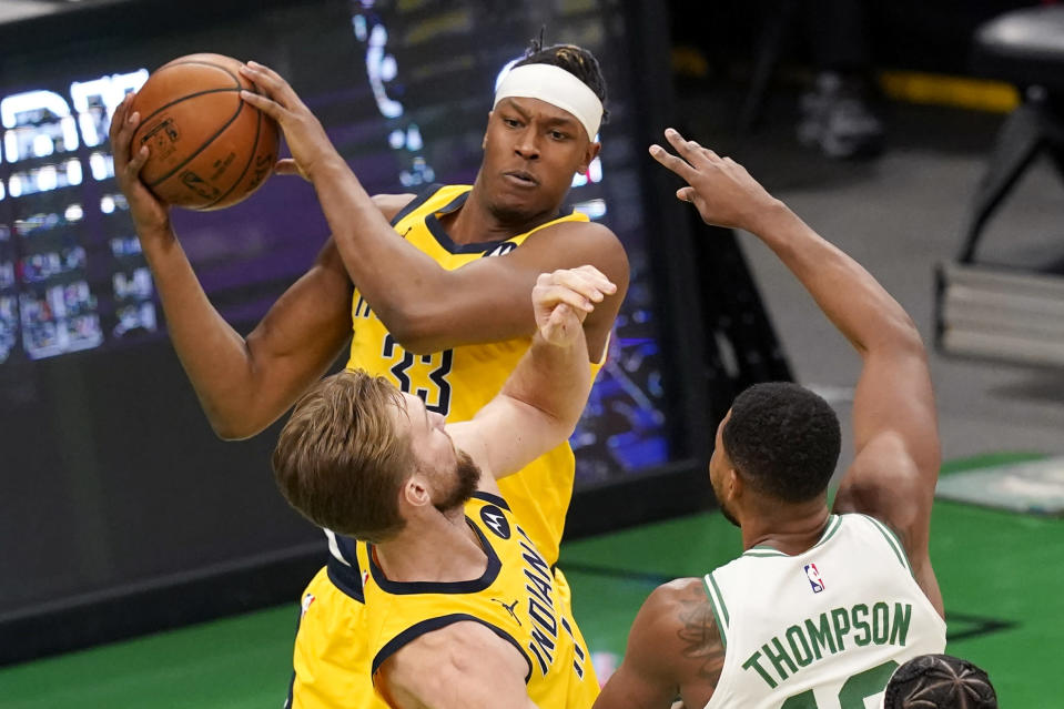 Indiana Pacers center Myles Turner (33) grabs a rebound next to Boston Celtics forward Tristan Thompson during the first quarter of an NBA basketball game Friday, Feb. 26, 2021, in Boston. (AP Photo/Elise Amendola)