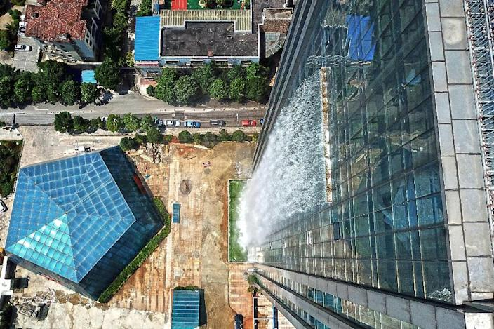 Although the Liebian International Building is not yet finished, the water feature was completed two years ago (AFP Photo/-)
