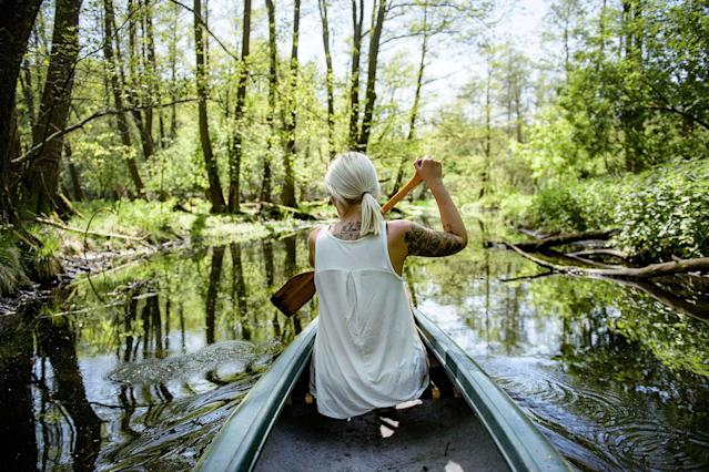 <p>A young woman paddles a canoe on the creek 'Loecknitz' in Brandenburg state on May 19, 2017 near Erkner, Germany. Brandenburg, with its multitude of waterways and lakes that are rich in plant and wildlife, is a popular destination for canoeing and other water sports enthusiasts. (Photo: Thomas Lohnes/Getty Images) </p>