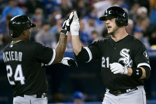 Chicago White Sox catcher Tyler Flowers, right, celebrates his three-run home run with teammate Dayan Viciedo, left, during the second inning of a baseball game in Toronto on Wednesday April 17, 2013. (AP Photo/The Canadian Press, Nathan Denette)