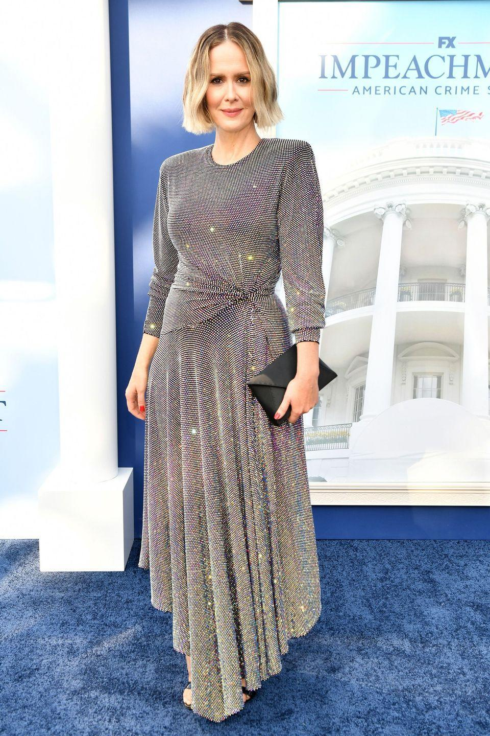 """<p><strong>1 September</strong></p><p>Sarah Paulson arrived at the premiere of <a href=""""https://www.harpersbazaar.com/uk/culture/culture-news/a37372956/impeachment-american-crime-real-story-explained/"""" rel=""""nofollow noopener"""" target=""""_blank"""" data-ylk=""""slk:Impeachment: American Crime Story"""" class=""""link rapid-noclick-resp"""">Impeachment: American Crime Story</a> wearing a glittering gunmetal Alexandre Vauthier dress. </p><p><a class=""""link rapid-noclick-resp"""" href=""""https://www.harpersbazaar.com/uk/culture/culture-news/a37372956/impeachment-american-crime-real-story-explained/"""" rel=""""nofollow noopener"""" target=""""_blank"""" data-ylk=""""slk:THE TRUE STORY BEHIND 'IMPEACHMENT'"""">THE TRUE STORY BEHIND 'IMPEACHMENT'</a></p>"""