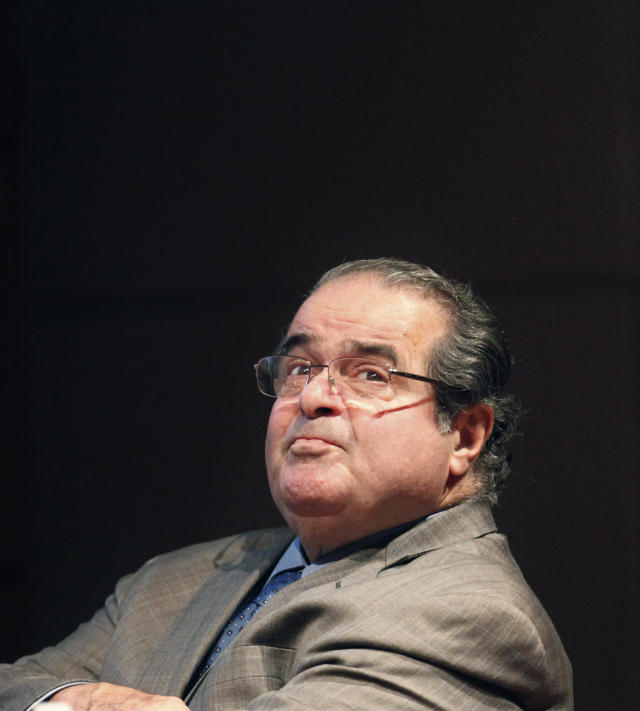 <p>When Supreme Court Justice Antonin Scalia, 79, died unexpectedly on February 13, his seat quickly became a political flashpoint. Senate Republicans refused to hold confirmation hearings on President Obama's pick to replace Scalia, Merrick Garland. — (Pictured) U.S. Supreme Court Justice Antonin Scalia looks into the balcony before addressing the Chicago-Kent College Law justice in Chicago in 2011. (AP Photo/Charles Rex Arbogast) </p>