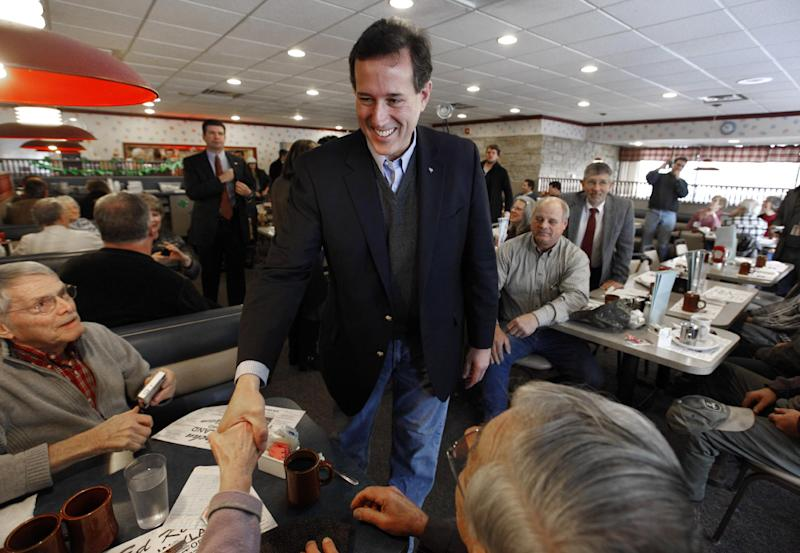 Republican presidential candidate, former Pennsylvania Sen. Rick Santorum greets diners at New Beginnings Restaurant in Kentwood, Mich., Tuesday, Feb. 28, 2012. (AP Photo/Paul Sancya)