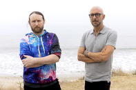 """Author Neil Strauss, right, and Incubus guitarist Mike Einziger, of the podcast """"To Live and Die in LA,"""" pose for a portrait on Thursday, June 17, 2021, in Malibu, Calif. Strauss is back with a second season of his podcast, focusing on the 2017 disappearance of Elaine Park, a 20-year-old woman last seen in Calabasas, California. (Photo by Willy Sanjuan/Invision/AP)"""