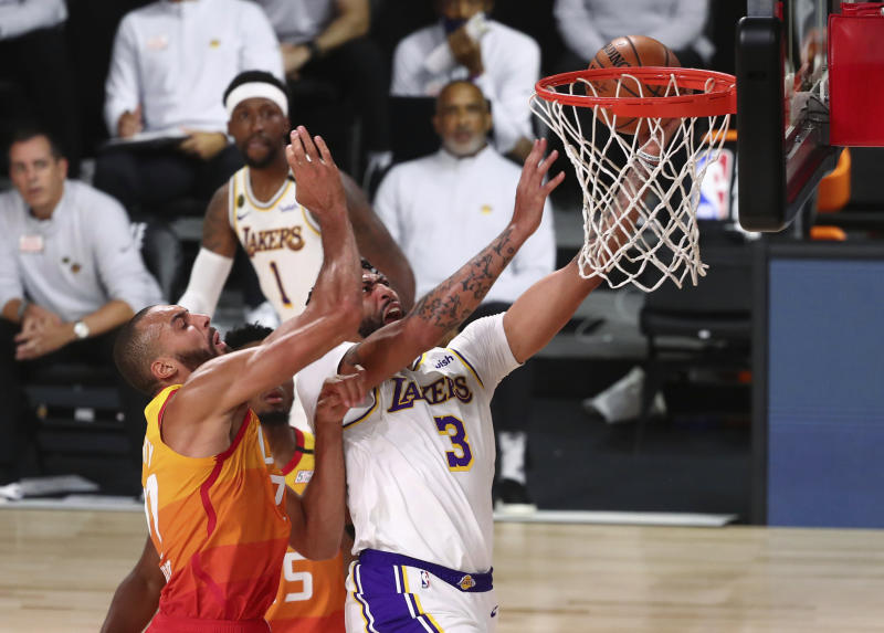Lakers beat Jazz 116-108 to clinch top seed in West