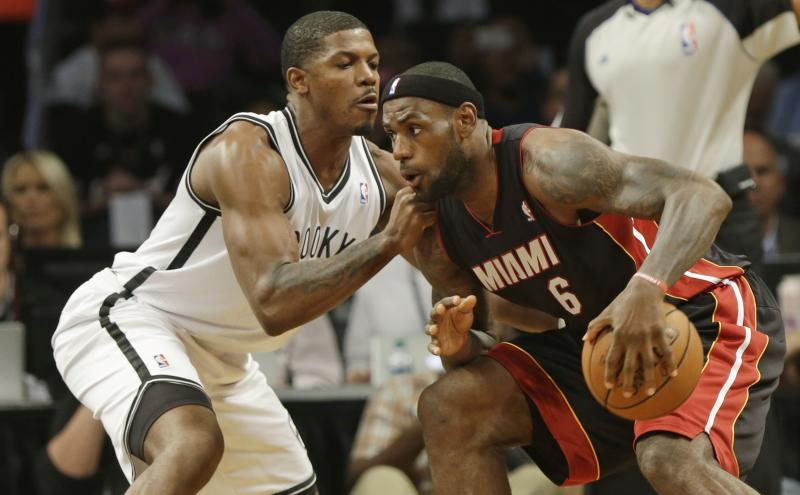 Brooklyn Nets' Joe Johnson, left, defends Miami Heat's LeBron James during the first half of an NBA basketball game Thursday, Oct. 17, 2013 in New York. (AP Photo/Frank Franklin II)