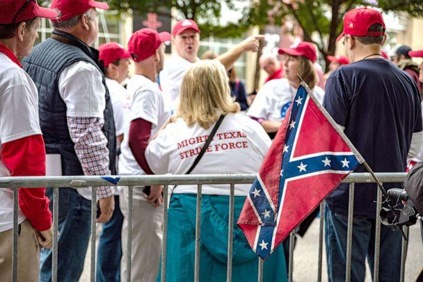PHOTO: An attendee displays a confederate flag while waiting in line outside the Toyota Center ahead of a rally with President Donald Trump and Senator Ted Cruz in Houston, Oct. 22, 2018. (Sergio Flores/Bloomberg via Getty Images)