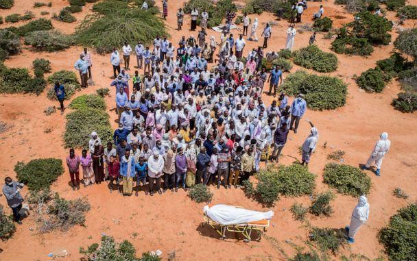 PHOTO: Mourners gather to bury an elderly man believed to have died of the coronavirus in Mogadishu, Somalia, April 30, 2020. (AP)