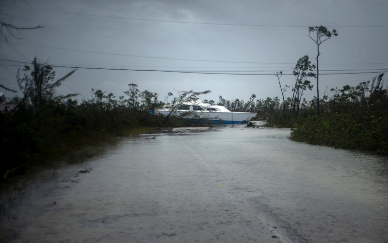 A catamaran thrown onshore by the hurricane lays stranded near a highway close to Freeport, Grand Bahama, Bahamas, Tuesday Sept. 3, 2019. (Photo: Ramon Espinosa/AP)