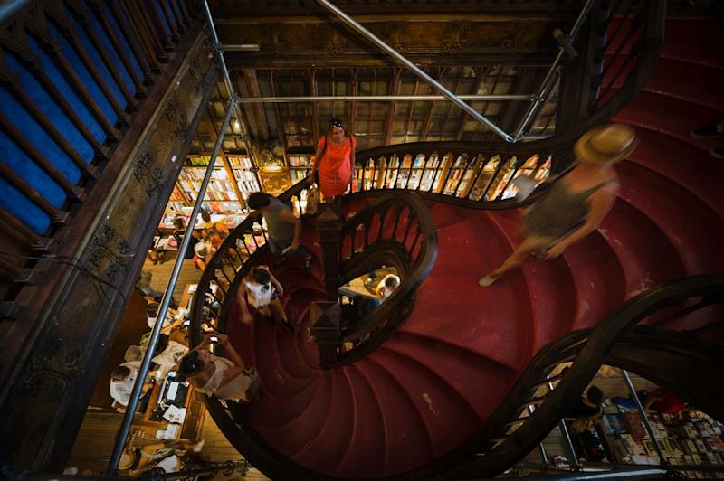 Tourists at Lello, a Gothic Revival style bookstore in the historic centre of Porto (AFP Photo/Miguel Riopa)