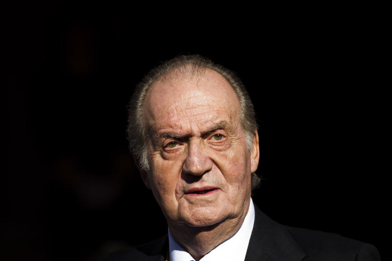 "FILE -  Spain's King Juan Carlos in this Tuesday, Dec. 27, 2011, file photo, leaves after the official opening of the Parliament, in Madrid. The 75-year old King Juan Carlos has left a hospital Saturday March 9, 2013, six days after successfully undergoing surgery for herniated discs in his lower spine, and he thanked waiting journalists and said ""I'm very well, my back doesn't hurt or anything,"" from the front passenger seat as he was driven home Saturday. (AP Photo/Daniel Ochoa de Olza, File)"