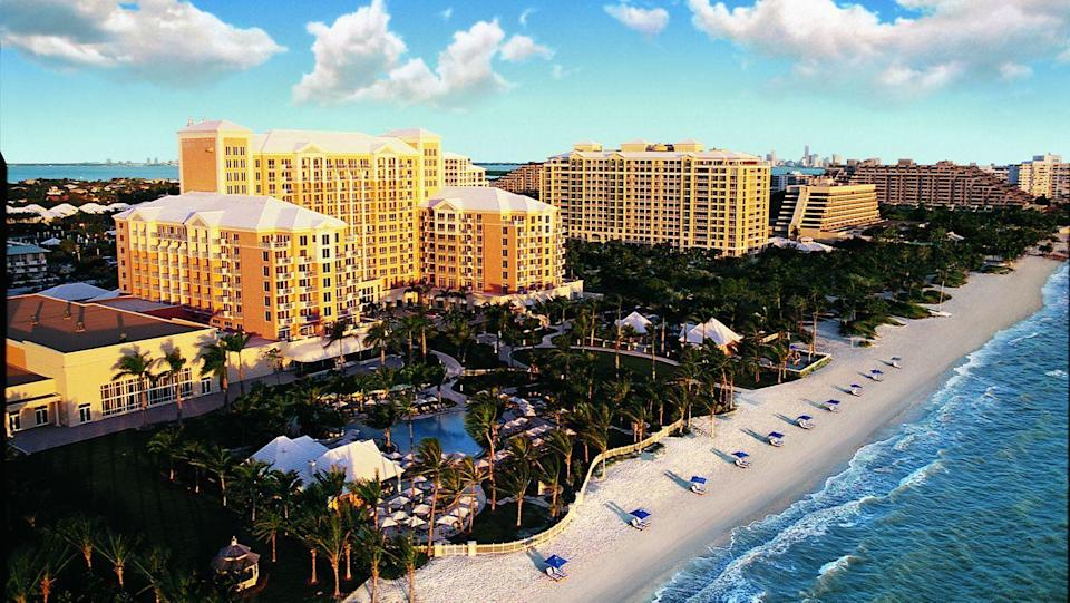 """<p><a href=""""https://www.ritzcarlton.com/en/hotels/miami/key-biscayne"""" rel=""""nofollow noopener"""" target=""""_blank"""" data-ylk=""""slk:The Ritz-Carlton Key Biscayne"""" class=""""link rapid-noclick-resp"""">The Ritz-Carlton Key Biscayne</a> is considered one of the luxury resort chain's best properties in the U.S., so it's a must for those looking for luxury in Miami. Key Biscayne is a five-mile barrier island just off the coast of the city and is easily accessible by car but still makes for an exclusive experience. If you're looking for an amazing view (and who isn't?), nearly every room and suite looks out onto either the Atlantic Ocean, Biscayne Bay, or the resort's tropical gardens. This Ritz property boasts its best tennis facility in the world, and its golden sand beach is regarded as one of America's best beaches, so those who expect the utmost need look no further than right here. </p>"""