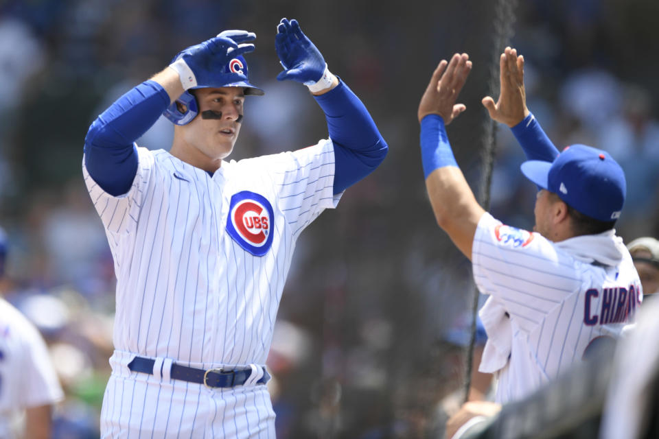 Chicago Cubs' Anthony Rizzo left, celebrates at the dugout with teammate Robinson Chirinos right, after hitting a solo home run during the first inning of a baseball game against the Arizona Diamondbacks Sunday, July 25, 2021, in Chicago. (AP Photo/Paul Beaty)