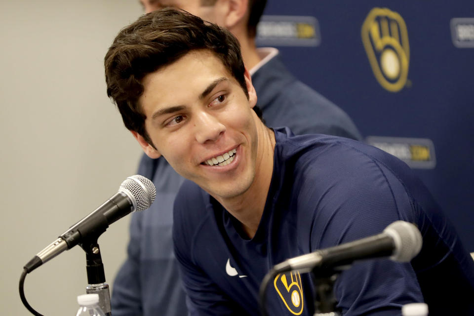 Milwaukee Brewers' Christian Yelich looks towards teammates after the Brewers announced his multi-year contract extension at the teams' spring training facility Friday, March 6, 2020, in Phoenix. (AP Photo/Matt York)