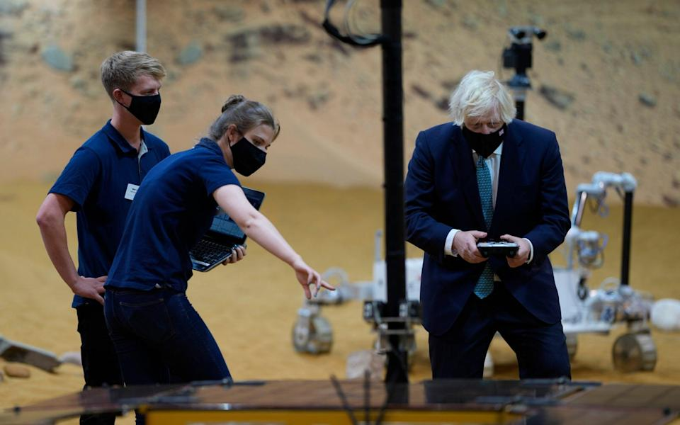 Boris Johnson tries out one of the prototype Mars Rovers - AP