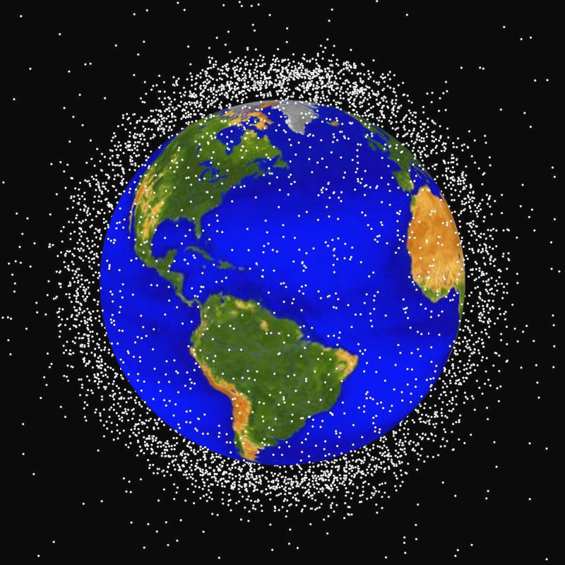 This computer generated graphic provided by NASA shows images of objects in Earth orbit that are currently being tracked.  Space junk has made such a mess of Earth's orbit that experts say we may need to finally think about cleaning it up. That may mean vacuuming up debris with weird space technology _ cosmic versions of nets, magnets and giant umbrellas, according to the chairman of an expert panel that issued a new report on the problem Thursday. (AP Photo/NASA)