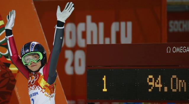 Hendrickson reacts after her jump in the first round of the women's ski jumping individual normal hill event at the Sochi 2014 Winter Olympic Games
