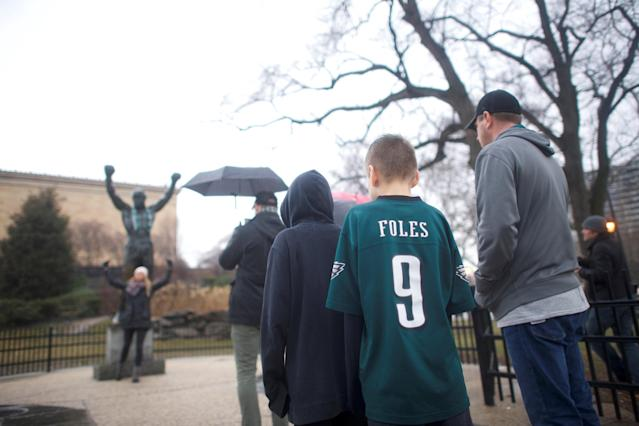 Chase Pritchard, 9, wears a Philadelphia Eagles quarterback Nick Foles jersey while waiting in line to take a photograph beside the Rocky statue, before the Super Bowl LII game between the Philadelphia Eagles and New England Patriots, in Philadelphia, Pennsylvania, U.S., February 4, 2018. REUTERS/Mark Makela