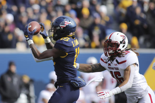 West Virginia's George Campbell (15) makes a catch as Texas Tech's Logan Greene (16) defends during their NCAA college football game in Morgantown, W.Va., Saturday, Nov. 9, 2019. (AP Photo/Chris Jackson)