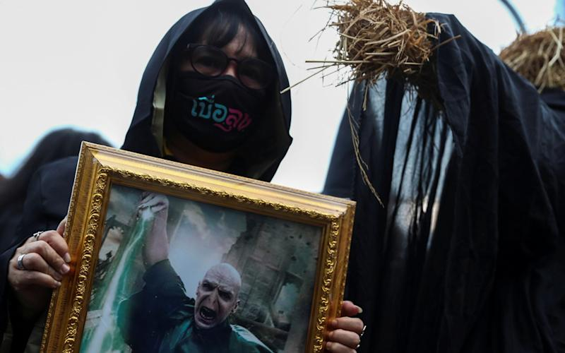 A Thai protester holds a picture of Lord Voldemort during an anti-government protest - Athit Perawongmetha/Reuters