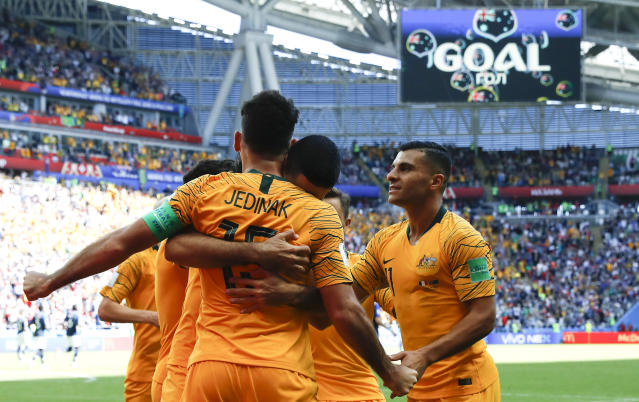 <p>Mile high club! Australia's Mile Jedinak is Mr Popular as he slotted home his penalty kick (AP) </p>