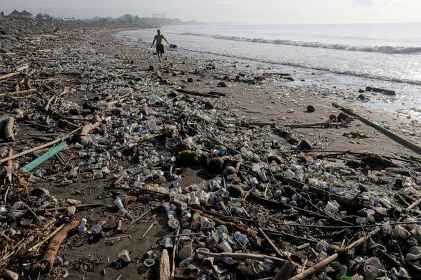 PHOTO: A local resident walks along a section of Matahari Terbit beach covered in plastic and other debris washed ashore by seasonal winds near Sanur, Bali, Indonesia, April 11, 2018. (Johannes P. Christo/Reuters, FILE)