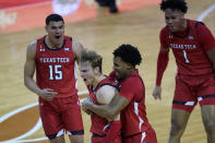 Texas Tech guard Mac McClung (0) is grabbed by guard Kyler Edwards (11) as they celebrate McClug's winning basket in the final seconds of the second half of an NCAA college basketball game against Texas, Wednesday, Jan. 13, 2021, in Austin, Texas. Texas Tech won 79-77. (AP Photo/Eric Gay)