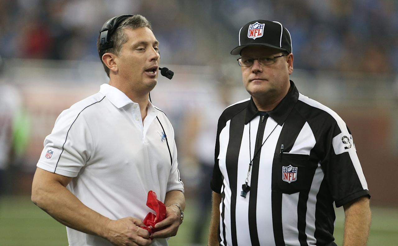 DETROIT, MI - NOVEMBER 22:  Detroit Lions head coach Jim Schwartz (L) talks with NFL official Jerry Bergman during a disputed play during the game against the Houston Texans at Ford Field on November 22, 2012 in Detroit, Michigan. The Texans defeated the Lions 34-31.  (Photo by Leon Halip/Getty Images)