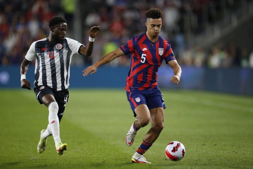 Costa Rica's Keysher Fuller, left, chases United States' Antonee Robinson up the field during the first half of a World Cup qualifying soccer match Wednesday, Oct. 13, 2021, in Columbus, Ohio. (AP Photo/Jay LaPrete)