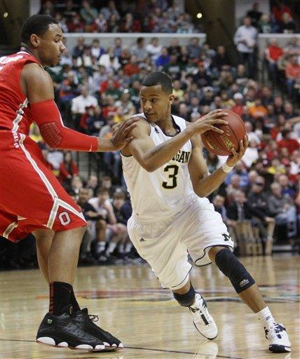 Michigan guard Trey Burke (3) drives around Ohio State forward Jared Sullinger in the first half of an NCAA college basketball game in the semifinals of the Big Ten Conference tournament in Indianapolis, Saturday, March 10, 2012. (AP Photo/Kiichiro Sato)