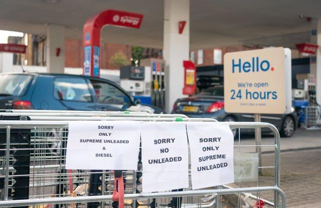 Signage indicating restricted availability of fuel at a petrol station in west London.