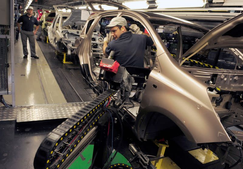 FILE PHOTO: An employee works on the production line at the Nissan car factory in Washington