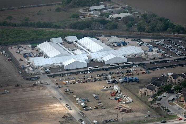 A temporary Customs and Border Protection processing center is seen from a Texas Department of Public Safety helicopter on March 23, 2021 in Donna, Texas. A surge of immigrants, including unaccompanied minors crossing into the United States from Mexico is overcrowding such centers in south Texas. (Photo by John Moore/Getty Images)