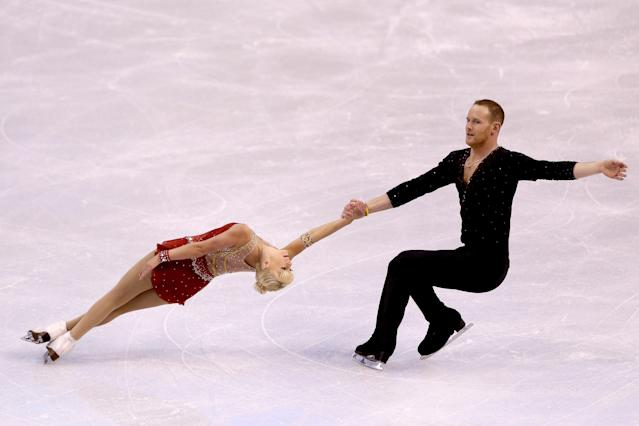 Bridget Namiotka alleged that her former figure skating partner, John Coughlin — seen here with Caydee Denney at the 2014 Prudential U.S. Figure Skating Championships — sexually abused her for two years in a series of Facebook posts on Sunday. (Matthew Stockman/Getty Images)