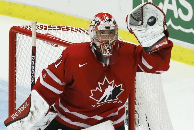 Canada's goalie Zachary Fucale makes a save against Switzerland during the third period of their IIHF World Junior Championship quarter-final ice hockey game in Malmo, Sweden, January 2, 2014. REUTERS/Alexander Demianchuk (SWEDEN - Tags: SPORT ICE HOCKEY)