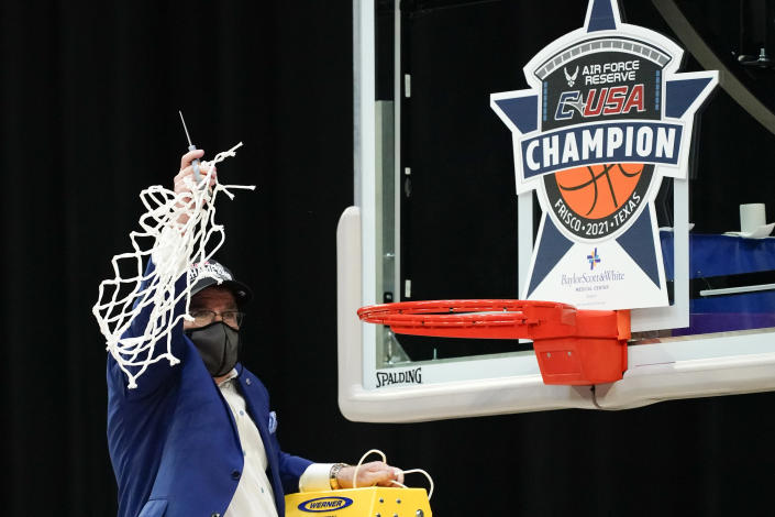 Middle Tennessee head coach Rick Insell celebrates after the championship game against Rice in the NCAA Conference USA women's basketball tournament Saturday, March 13, 2021, in Frisco, Texas. Middle Tennessee won 68-65. (AP Photo/Tony Gutierrez)