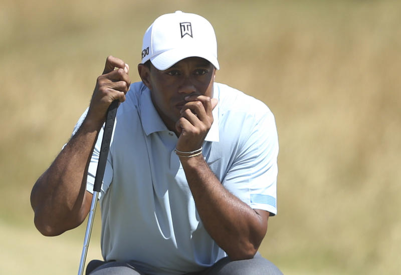 Tiger Woods of the United States lines up a putt on the 14th green during the second round of the British Open Golf Championship at Muirfield, Scotland, Friday July 19, 2013. (AP Photo/Scott Heppell)
