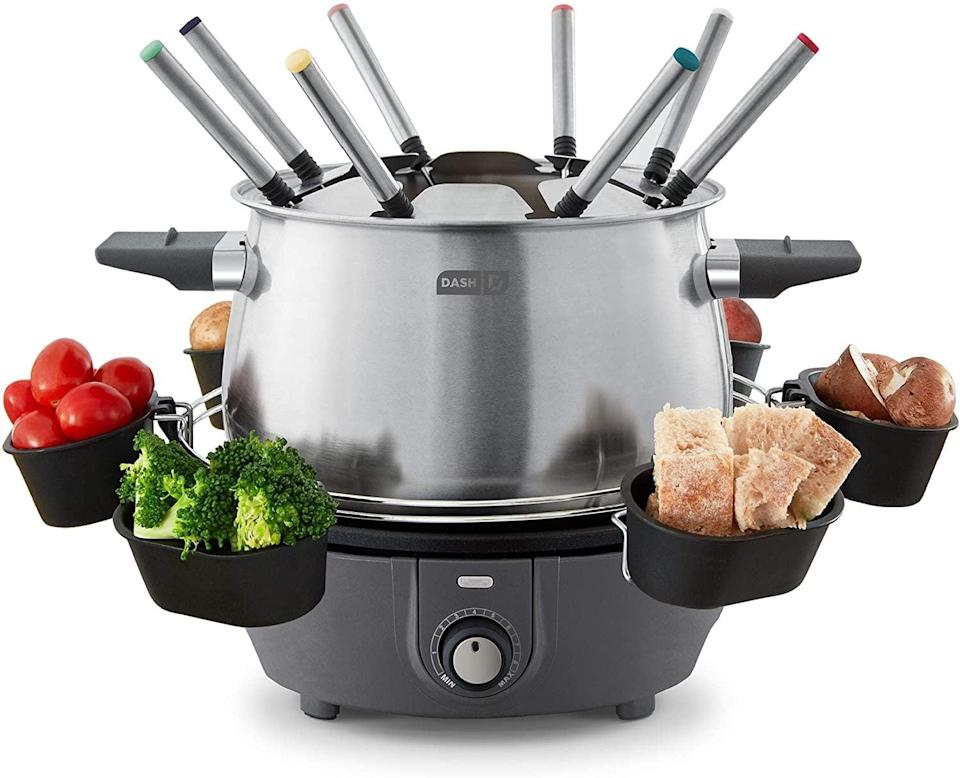 <p>How fun is this <span>Dash Deluxe Stainless Steel Fondue Maker </span> ($50)!? It comes with with temperature control, forks, cups, and a rack so you can fondue your heart out. </p>